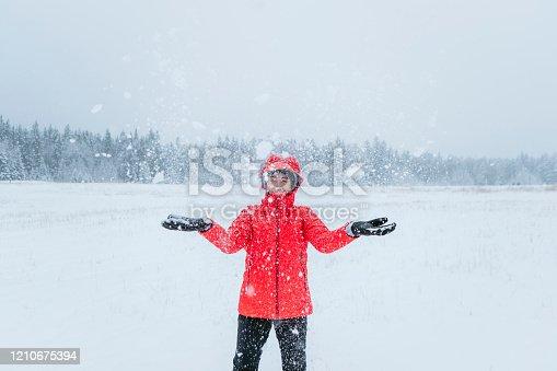 woman playing snow at banff nation park, canada.