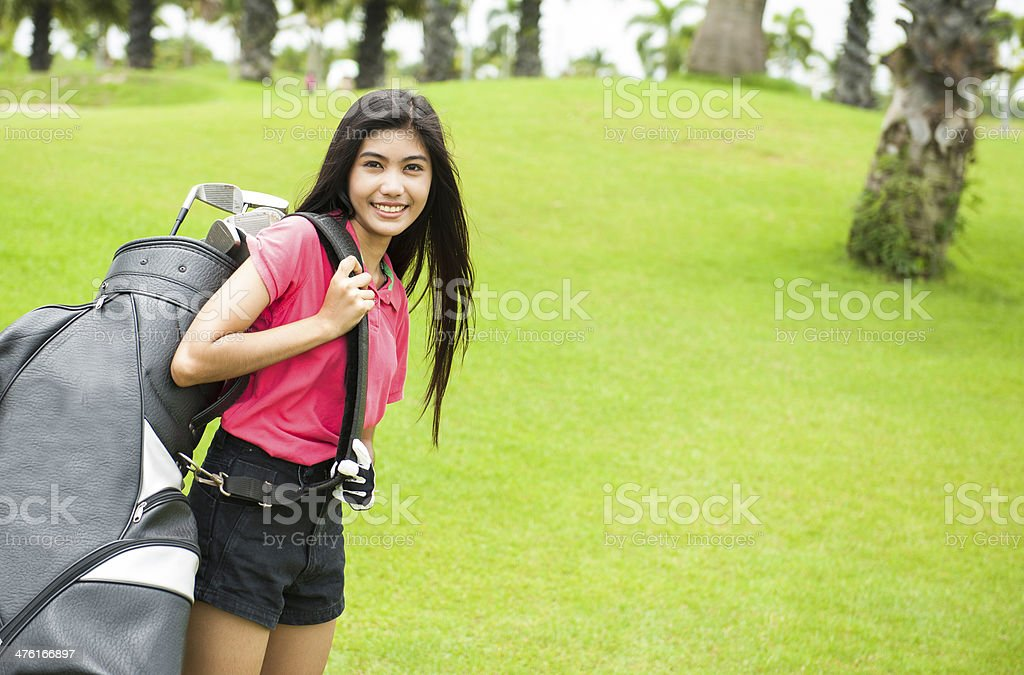 Woman player carry a golf bag royalty-free stock photo