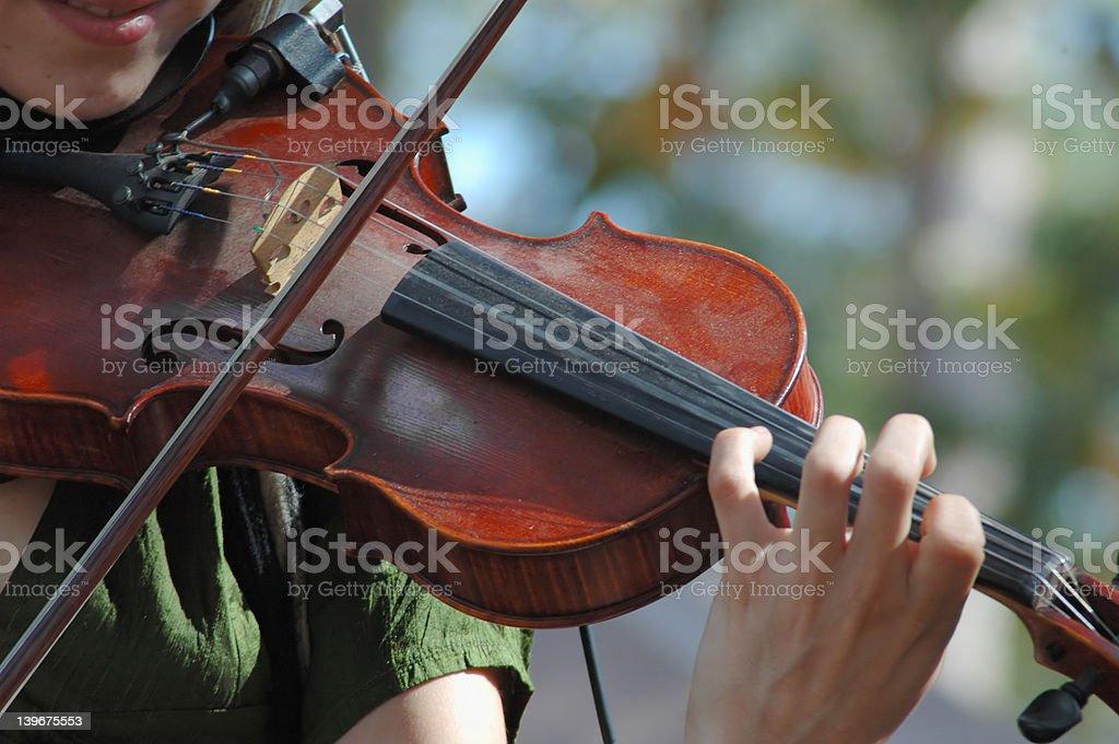 Woman playing a violin stock photo