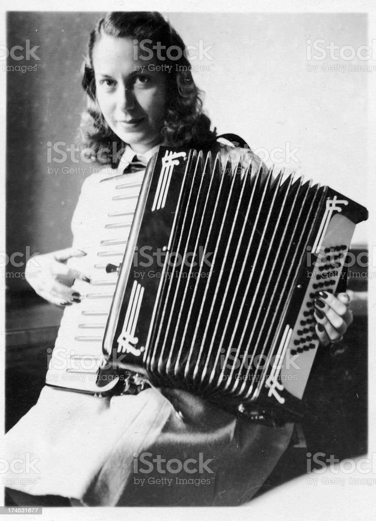 Woman Playing Accordion in 1933,Black And White stock photo