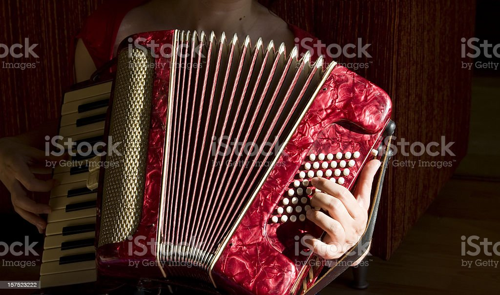 Woman playing accordion stock photo