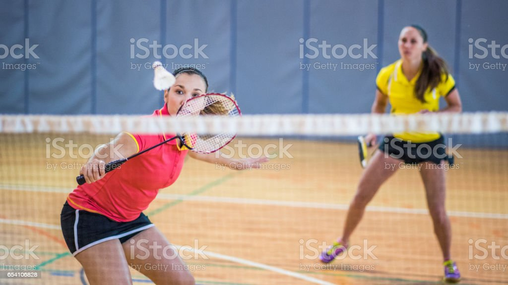 Woman playing badminton stock photo