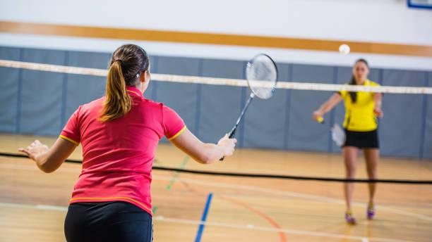 Woman playing badminton stock photo
