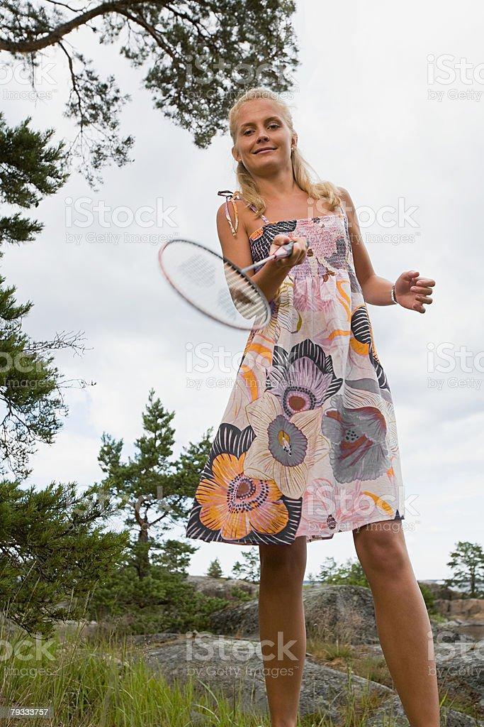A woman playing badminton royalty-free stock photo