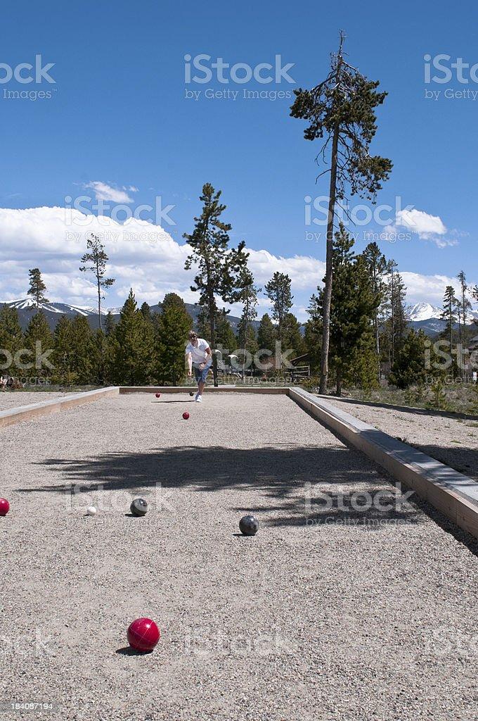 Woman Playing Bocce stock photo