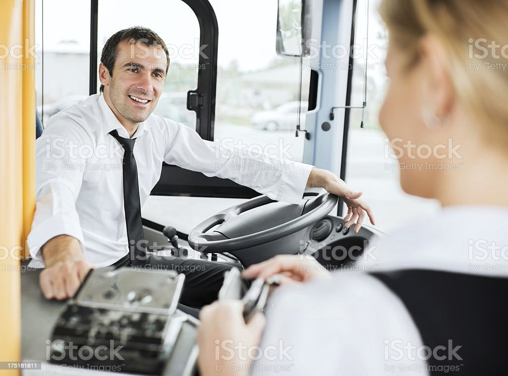 Woman playing bus fares stock photo