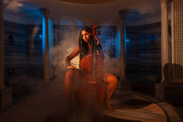 Woman playing cello in Turkish bath stock photo
