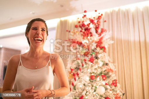 istock Woman Playing Charades At Christmas - Amigo Secreto 1083666778