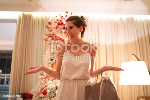 istock Woman Playing Charades At Christmas - Amigo Secreto 1083666782