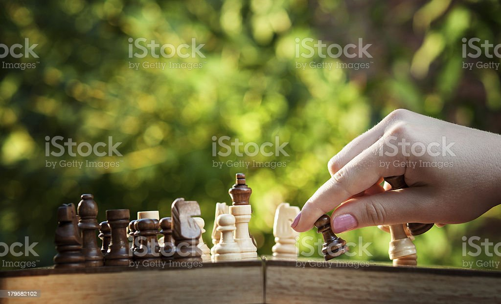 woman playing chess royalty-free stock photo