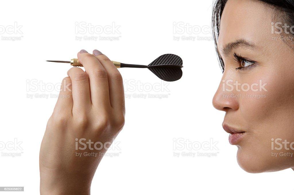 Woman Playing Darts stock photo