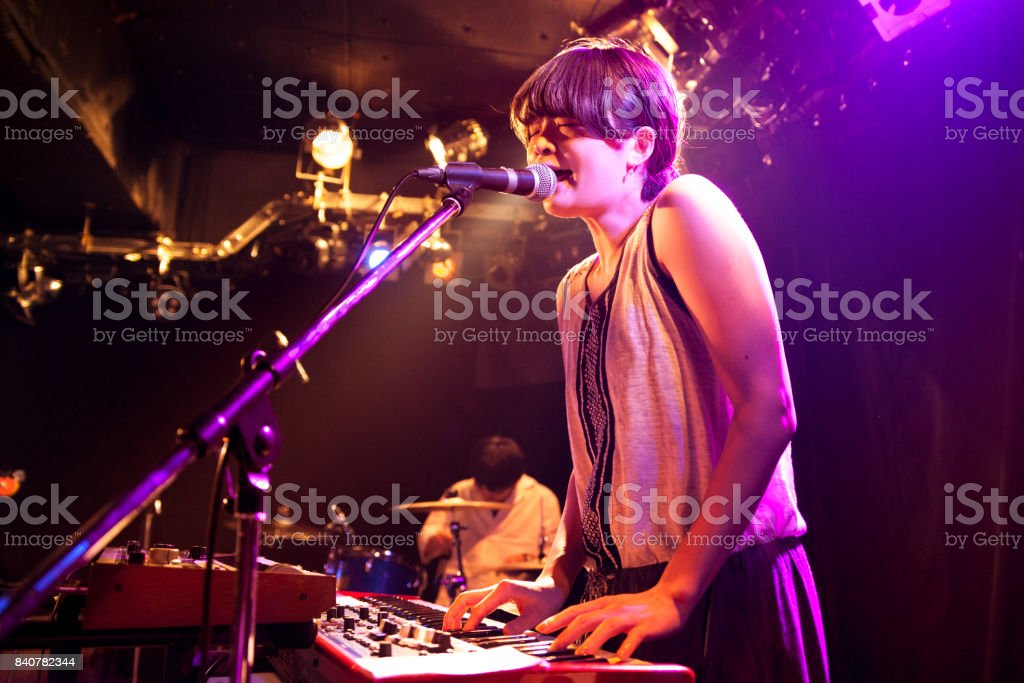 Woman Playing Electronic Keyboard At Live Event stock photo