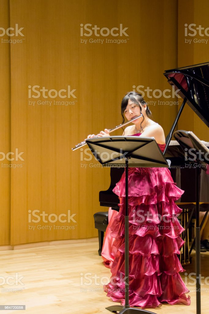 Woman Playing Flute in a Concert royalty-free stock photo