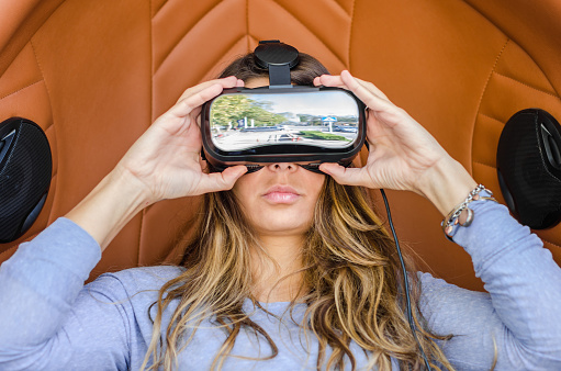 istock Woman playing game in virtual reality glasses 619765774