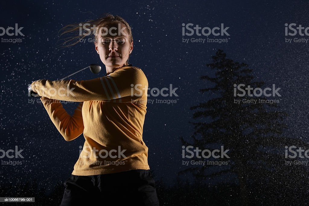 Woman playing golf, low angle view royalty-free stock photo