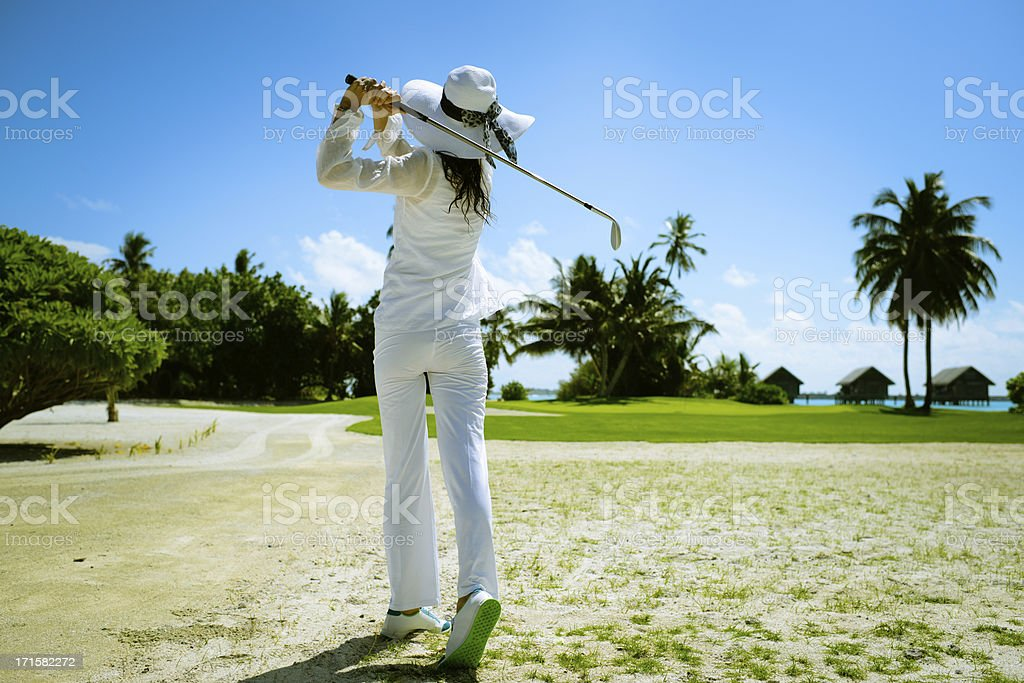 Woman Playing Golf stock photo