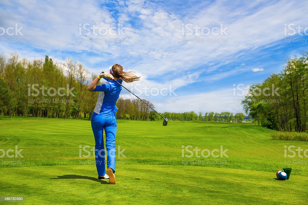 Woman playing golf stock photo
