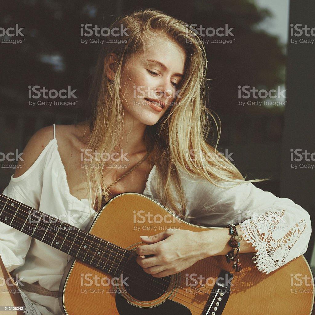 Woman Playing Guitar Music Beautiful Concept stock photo