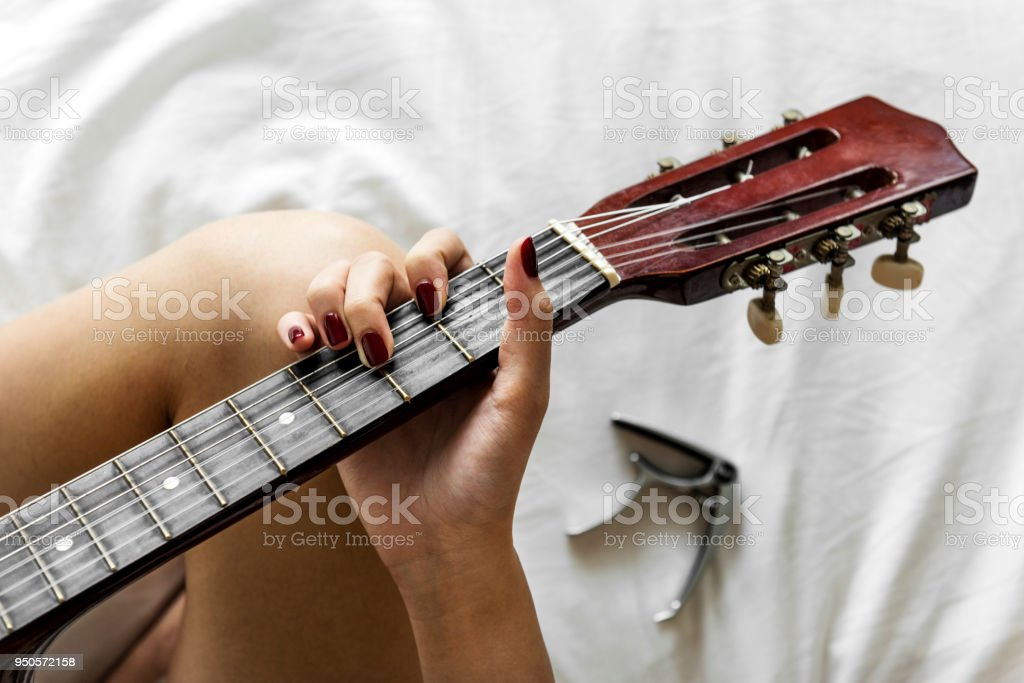 Woman Playing Guitar On The Bed Stock Photo More Pictures Of Adult