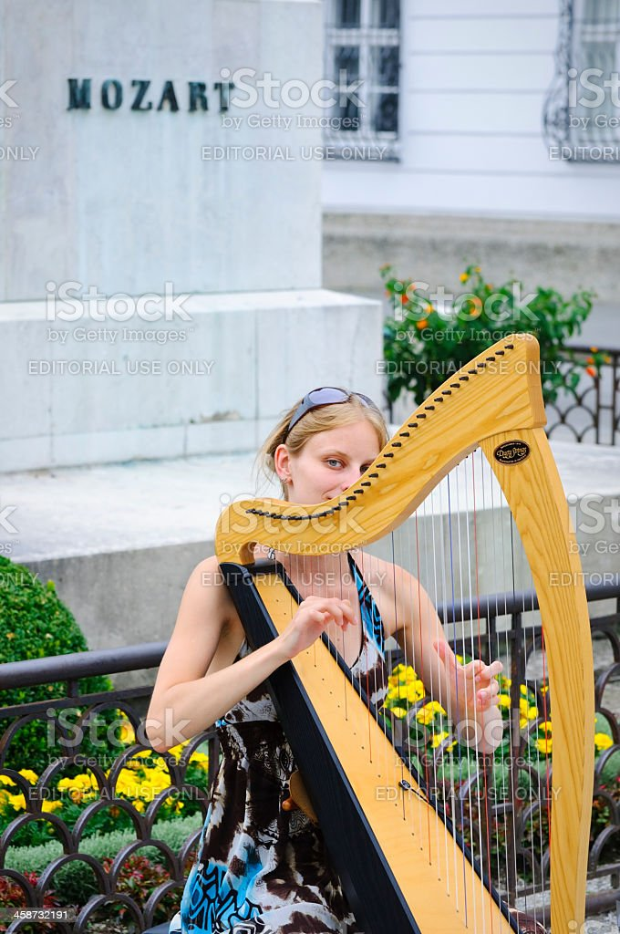 Woman playing harp in Salzburg, Austria royalty-free stock photo
