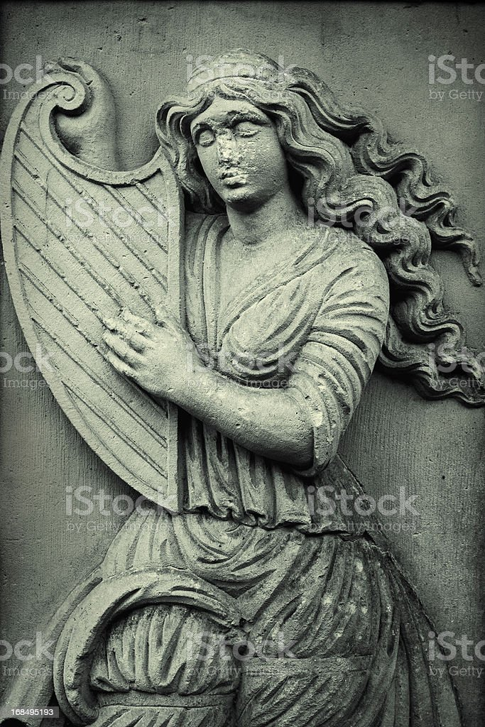 Woman playing harp stock photo