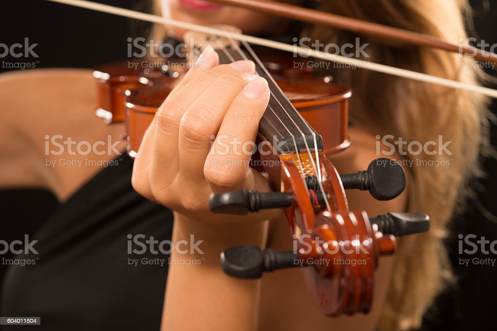 Woman playing her violin stock photo
