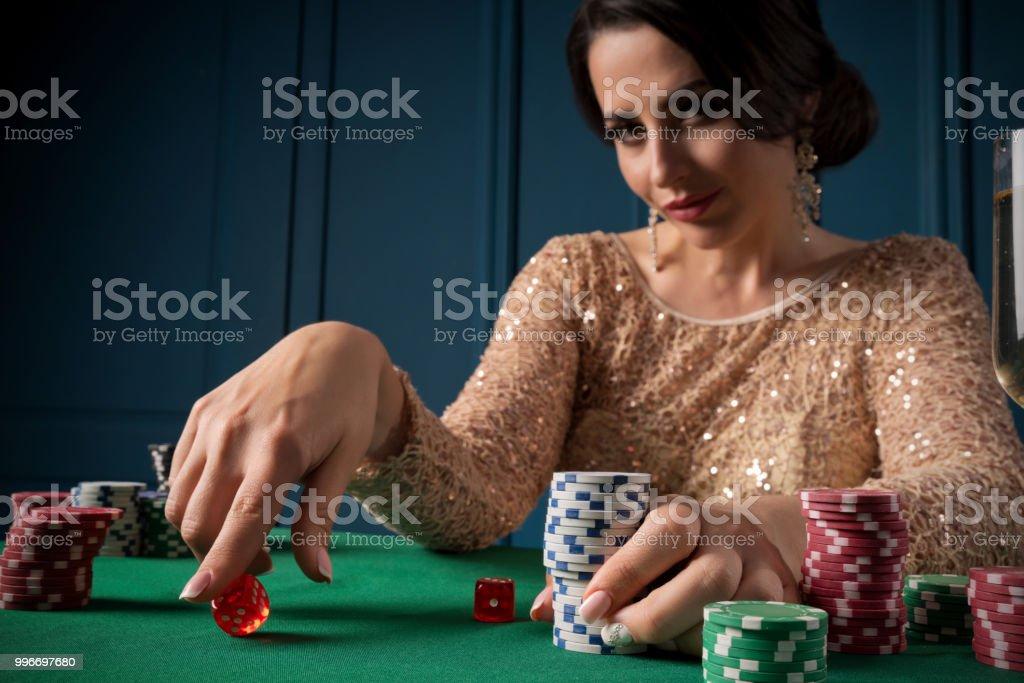 Woman playing in casino stock photo