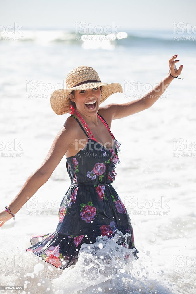 Woman playing in surf royalty-free stock photo