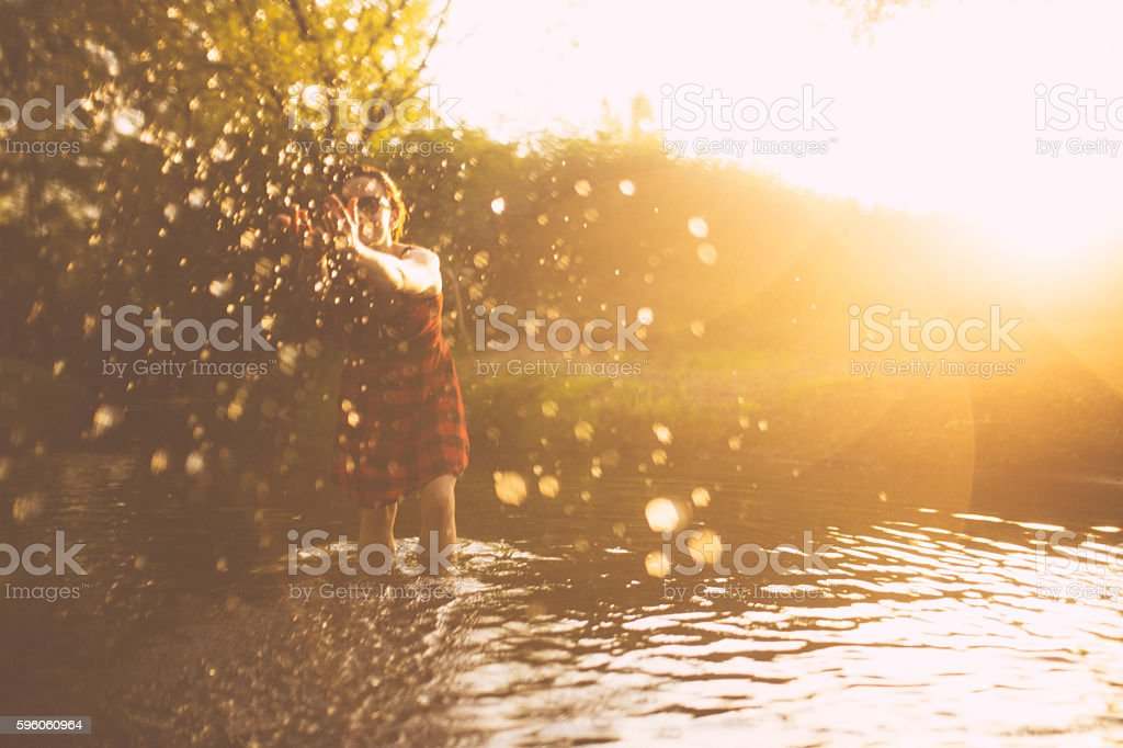 Woman playing in the river royalty-free stock photo