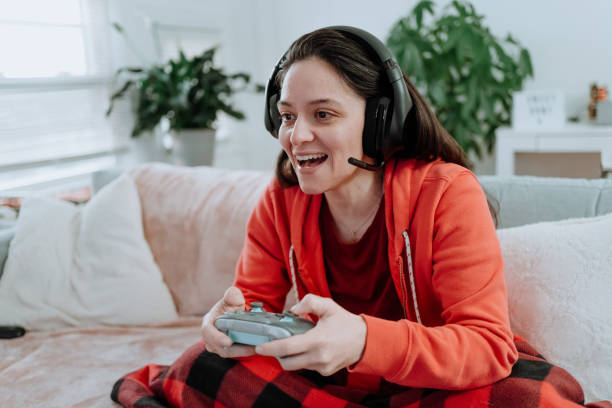 Woman playing multiplayer online games stock photo