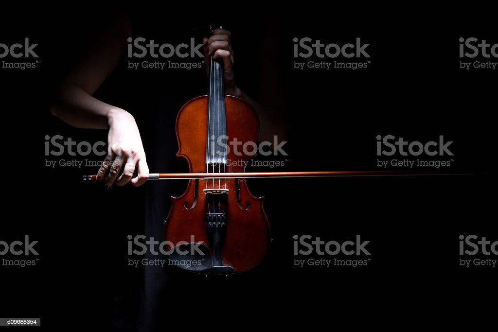 Woman playing on violin stock photo