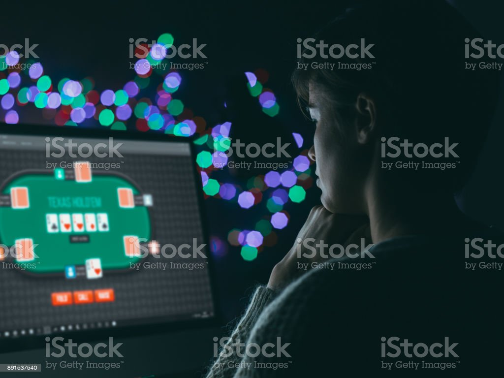 Woman playing online poker stock photo