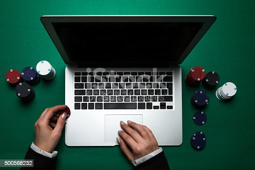 istock Woman playing online poker with laptop , top view 500568232