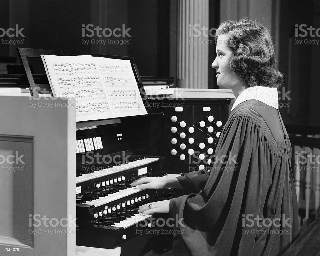 Woman playing organ in church royalty-free stock photo