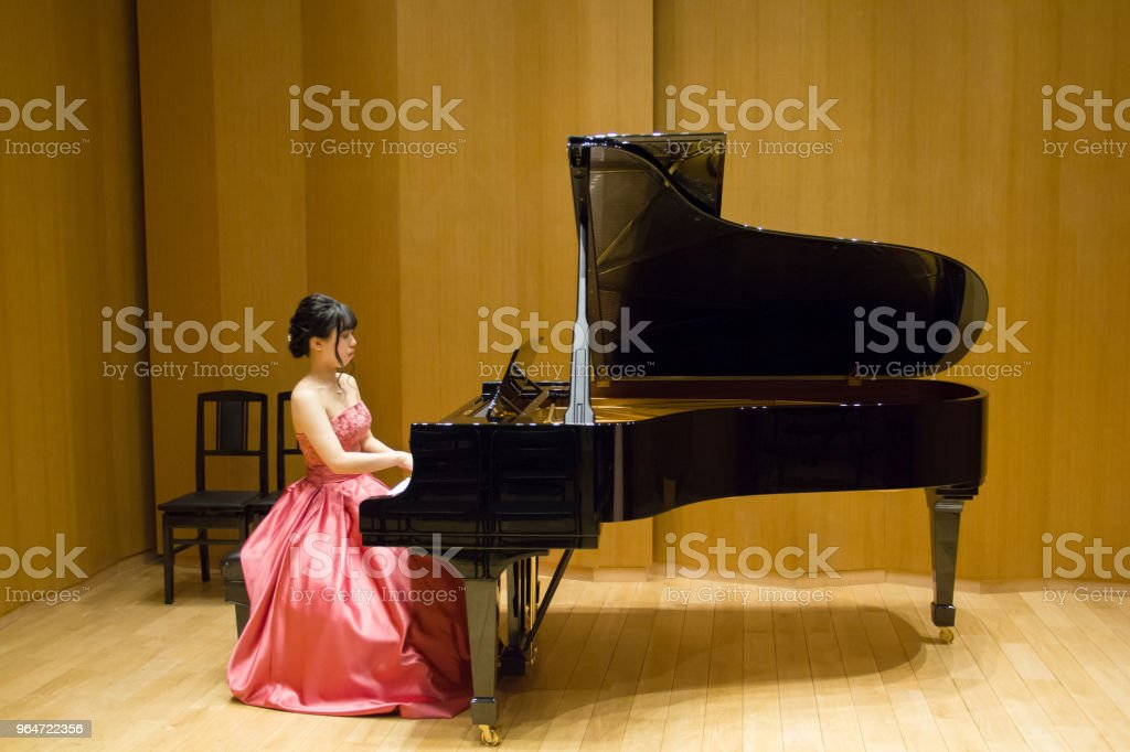 Woman Playing Piano in a Concert, Rehearsal royalty-free stock photo