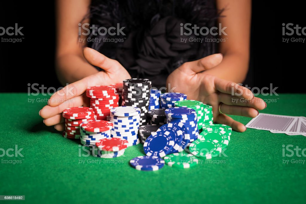 Woman playing poker with all in stock photo