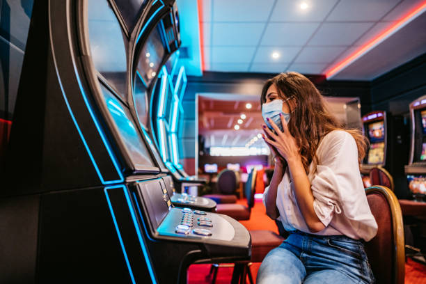 154 Cheerful Female Casino Players At Slot Machines Europe Stock Photos,  Pictures & Royalty-Free Images - iStock