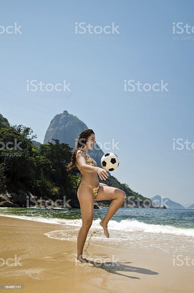 Woman playing soccer on beach royalty-free stock photo