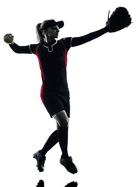 woman playing softball players silhouette isolated - softball stock photos and pictures