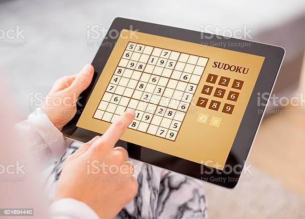 Woman playing sudoku on tablet computer picture id624894440?b=1&k=6&m=624894440&s=612x612&h=wsqpu35d8d3b xdwiyye9wrk5bngqyuie8hae248jnw=