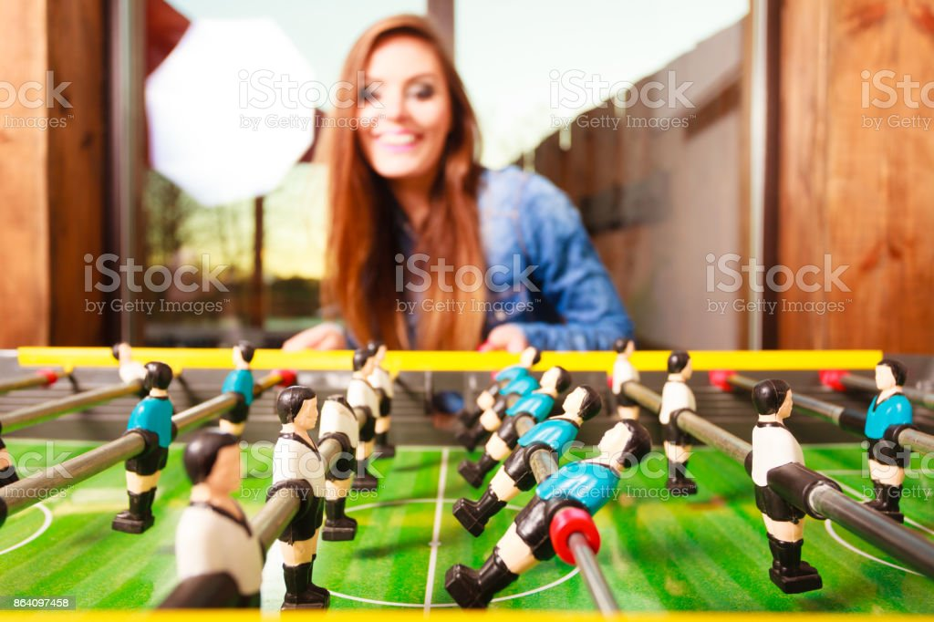woman playing table football game royalty-free stock photo