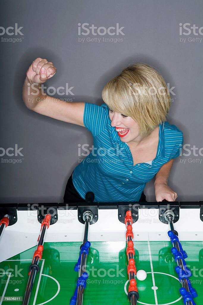 Woman playing table football royalty-free 스톡 사진