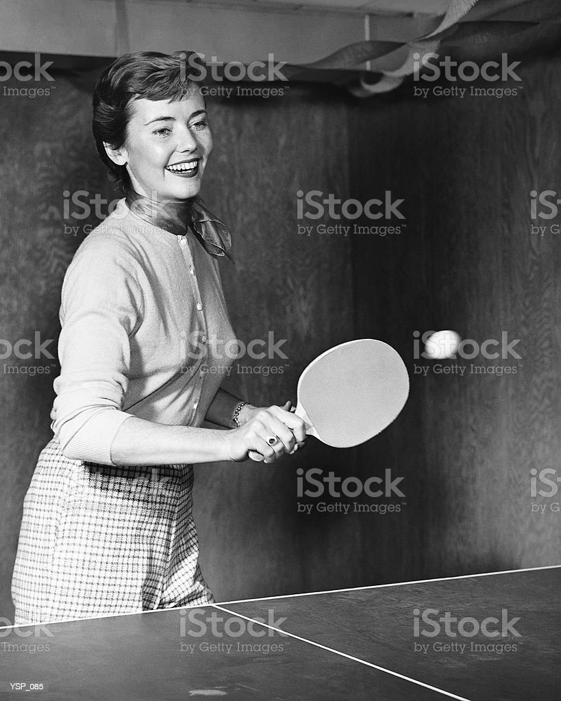 Woman playing table tennis royalty free stockfoto