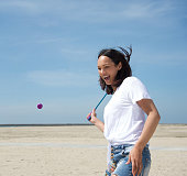 istock Woman playing tennis at the beach 501064051