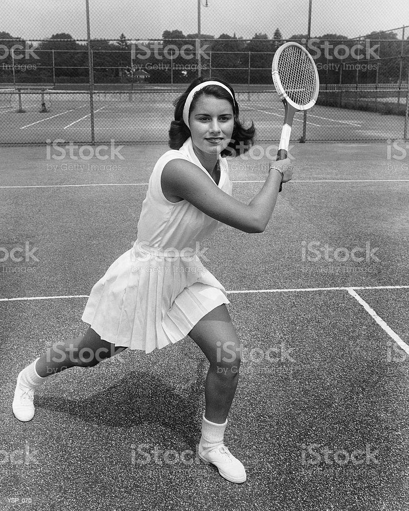 Mujer jugando al tenis foto de stock libre de derechos