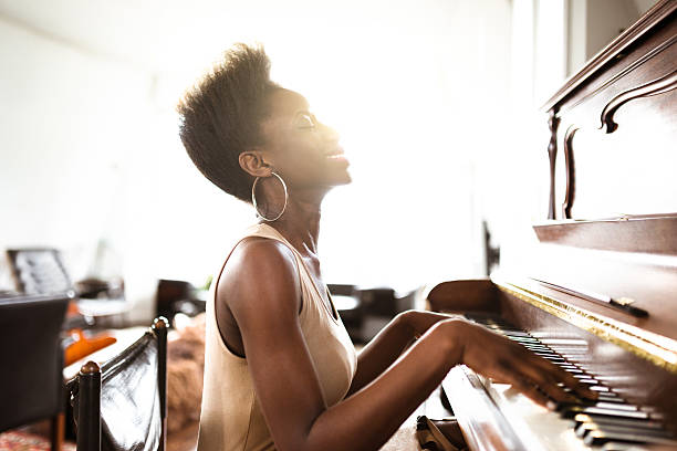 woman playing the piano woman playing the piano passion stock pictures, royalty-free photos & images
