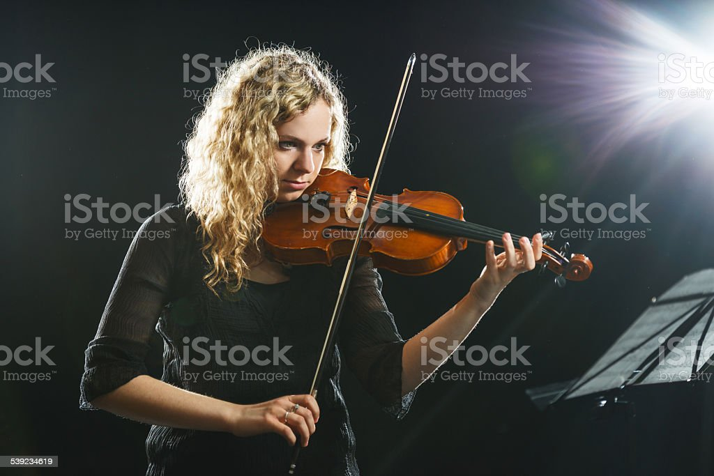 Woman playing the violin. royalty-free stock photo