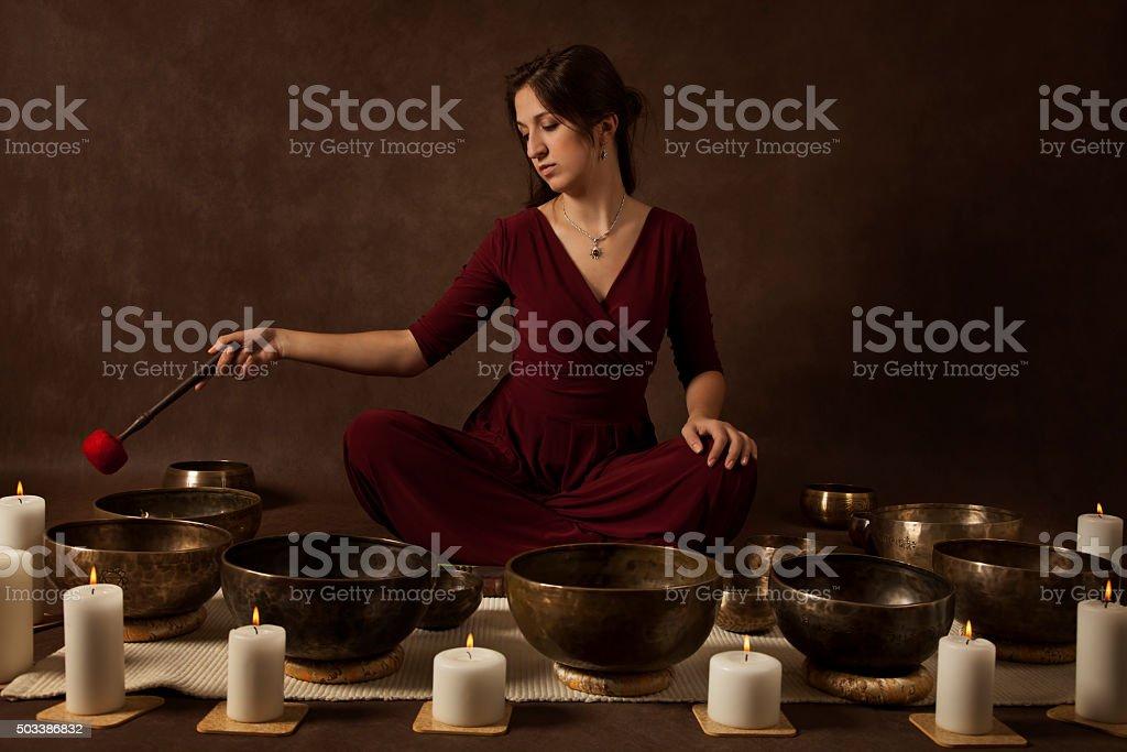 Woman playing Tibetan bowls stock photo