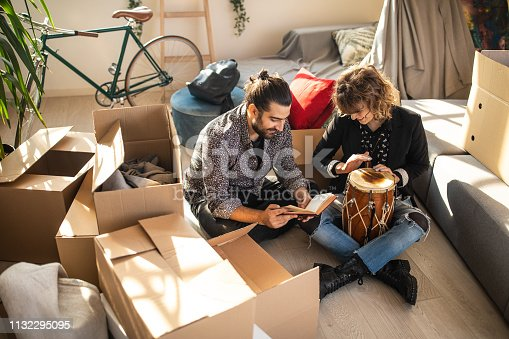 849355030istockphoto Woman playing timpani while man reading a book 1132295095