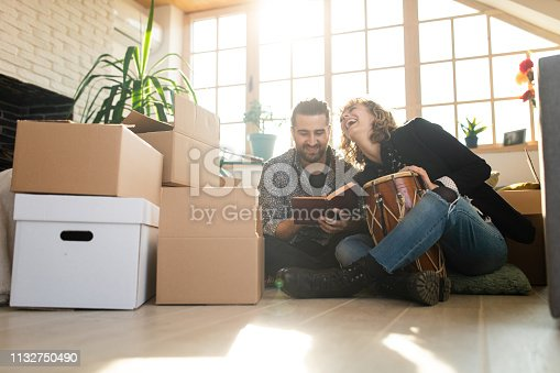 849355030istockphoto Woman playing timpani while man reading a book 1132750490